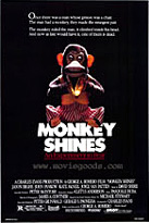"A movie poster. On a black background is a toy monkey holding cymbols and wearing pinstriped pants. It's sitting above the words ""Monkey Shines,"" which are written in huge white block letters. Under them, in red letters and underlined, reads: ""An Experiment in Fear."""